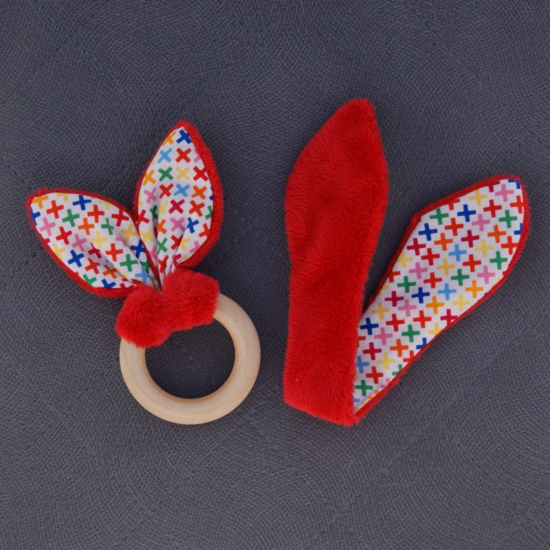 Teether – bunny ears - smooth red / colourful x's white background
