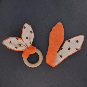 Naturalny gryzak pomarańczowy gwiazdki na kremowym handmade